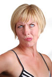 Perplexed blonde lady Stock Photo