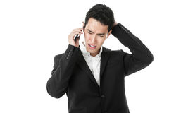 Perplexed businessman answering phone call Royalty Free Stock Photography