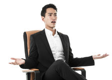 Perplexed Businessman on a chair Stock Photos