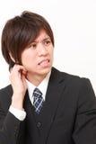 Perplexed businessman Stock Images