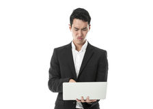 Perplexed Businessman using laptop Stock Photos