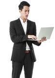 Perplexed Businessman using laptop Stock Photo