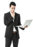 Perplexed Businessman using laptop Royalty Free Stock Images