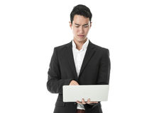 Perplexed Businessman using laptop Stock Images
