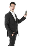 Perplexed businessman using a phone Stock Photos