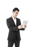 Perplexed Businessman using a tablet Stock Photography