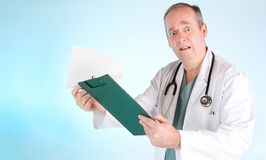 Perplexed Doctor Reading Out Medical Test Result stock images