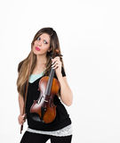 Perplexed girl with her violin Stock Photo