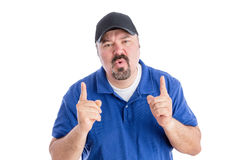 Perplexed man pointing upwards Stock Photography