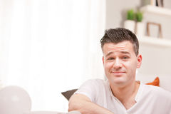 Perplexed man sly smiling asking if you are sure royalty free stock image