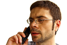 Perplexed Man Talking By Phone Royalty Free Stock Photos