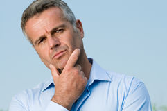 Perplexed mature man Stock Images