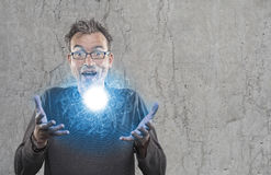 Perplexed scientist shows newly developed light plasma Royalty Free Stock Images