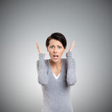 Perplexed woman puts her hands on the head royalty free stock image