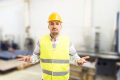 Perplexed workman asking gesture. As untrained technician electrician person concept on company or factory background Royalty Free Stock Photos