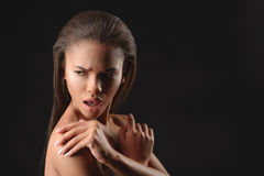 Perplexed young african woman hiding her nudity Royalty Free Stock Photos