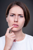 Perplexed young female Royalty Free Stock Photography