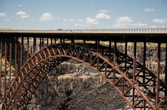 Perrine Bridge Midpoint. Popular base jumping bridge and cliff face in background Stock Image