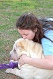 Perro adolescente triste deprimido de la muchacha Imagen de archivo libre de regalías