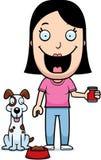 Perro de alimentación de la mujer de la historieta Fotografía de archivo libre de regalías