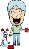 Perro de alimentación de la mujer de la historieta Imagen de archivo