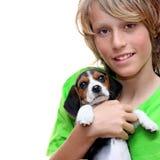 Perro de animal doméstico de la explotación agrícola del niño Imagenes de archivo