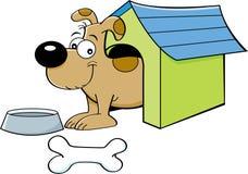 Perro de la historieta en una caseta de perro Imagen de archivo