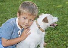 Perro del muchacho Fotografía de archivo
