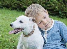 Perro del muchacho Fotos de archivo libres de regalías