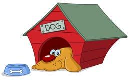 Perro en caseta de perro Fotografía de archivo