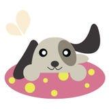 Perro en una alfombra Imagen de archivo