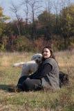 Perro feliz y su dueño Imagen de archivo libre de regalías