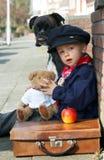 Perro, peluche y muchacho Foto de archivo libre de regalías