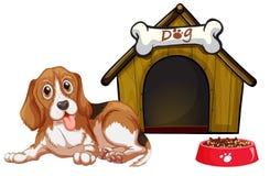 Perro y casa Imagenes de archivo