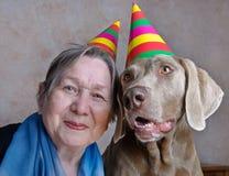 Perro y mujer mayor Imagenes de archivo