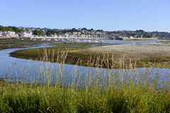Perros-Guirec in France. Perros-Guirec at low tide with port and town in the background, a commune in the Côtes-d'Armor department in Brittany in northwestern Royalty Free Stock Photo