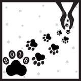 Perros negros de las huellas en hands3 fotografía de archivo