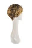 Perruque de cheveux au-dessus de la tête de mannequin Photo stock