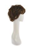Perruque de cheveux au-dessus de la tête de mannequin Photographie stock libre de droits