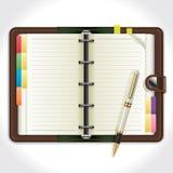 Persönlicher Organisator mit Stift. Stockbild