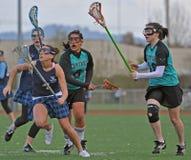 Persecución del lacrosse para la bola Foto de archivo libre de regalías