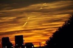 Perseguindo meu carro no por do sol? Fotografia de Stock Royalty Free