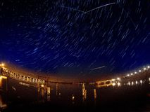 Perseid meteor shower with multiple meteor streaks and star trails Stock Photo