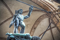 Perseo holding Medusa head statue in Loggia de Lanzi Stock Photos