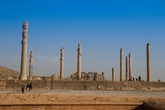 Persepolis is the capital of the Achaemenid kingdom. sight of Iran. Ancient Persia. Bas-relief on the walls of old buildings. Walls of the ancient capital of stock photos