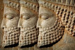 Persepolis is the capital of the ancient Achaemenid kingdom. Iran. Ancient Persia. Bas-relief carved on the walls of old buildings. Ancient background stock image