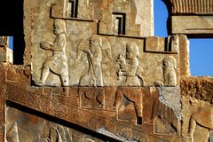 Persepolis is the capital of the ancient Achaemenid kingdom. Sight of Iran. Ancient Persia. Bas-relief carved on the walls of old buildings. Subjects donate Stock Photography