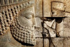 Persepolis is the capital of the ancient Achaemenid kingdom. sight of Iran. Ancient Persia. Bas-relief carved on the walls of old buildings stock photography