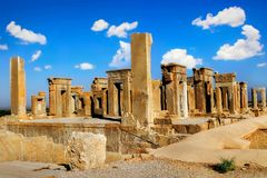 Persepolis is the capital of the ancient Achaemenid kingdom. Sight of Iran. Ancient Persia. Blue sky and clouds background Royalty Free Stock Photos