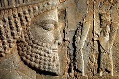 Persepolis is the capital of the ancient Achaemenid kingdom. sight of Iran. Ancient Persia. Bas-relief carved on the walls of old buildings stock image